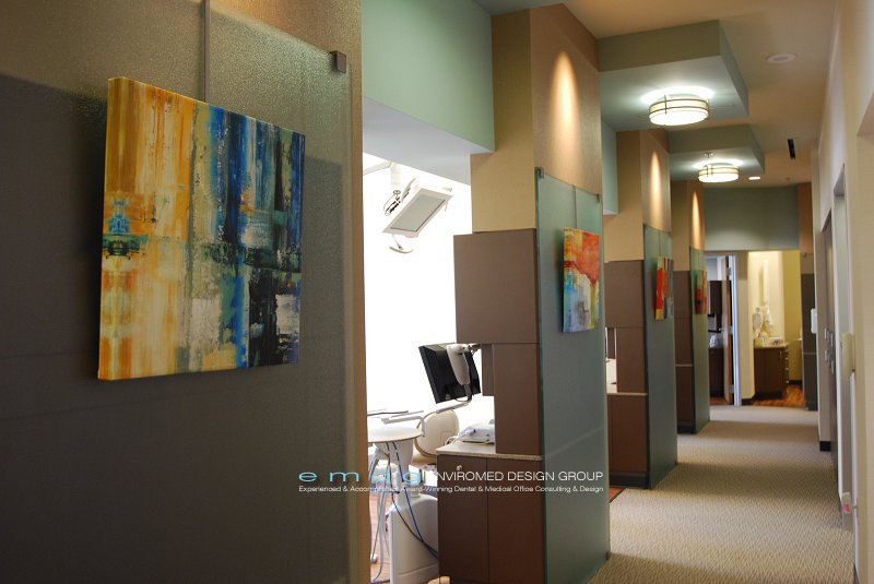 This modern dental office corridor shows our approach for combining retail dental equipment on the utility wall and custom detailing for the corridor and