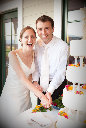 Wedding photography of bride and Groom cutting the cake