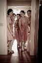 Bridesmaids peeking through the door